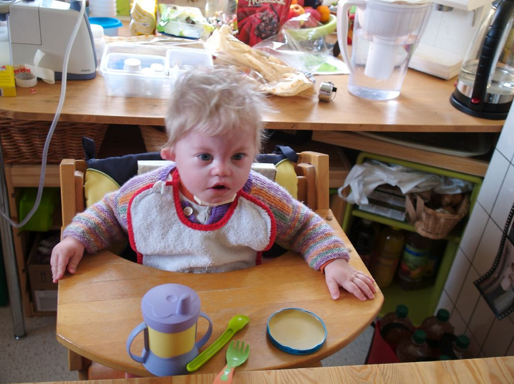 Monday 15th Jan 2007 - Cai is sitting much better every day and now we bring him to the table when we eat, in the bottle lid is apple juice that he can splash about and maybe put on his fingers to taste (if he can taste that is).