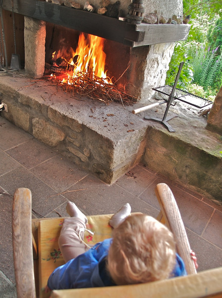 Sunday 10th Jun 2006 - Cai  relaxes in front of the fire waiting for the BBQ to start.<br /> <br /> Cai has been ill since returning from the charge conference (so have a few of the other chargers), he has been having high temperatures and excessive secretions. we are managing to keep him out of hospital but he is needing a lot of attention at the moment.<br /> <br /> This saturday we had a rare night out with full nursing cover from 6pm untill 10am Sunday (this was great because normally one of us has to get up at 6:30 after a night out). Anyway what do parents of a handicapped child do when they are given freedom - yes thats right go out and enjoy themselves. Having heard a rumour that the eurocrats in brussels have been busy again and the latest thing they want to do is  ban dancing on chairs and tables for  health and safety reasons  we headed to a beer keller in zurich to enjoy it while still legal. There is something about singing with a beer in hand followed by a good nights sleep that refreshes like no other, spectating however doesn't work.