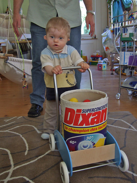 Monday 25th Jun 07 - Cai manages to walk without parent intervention.<br /> <br /> Cai can now push his trolley along on his own, this is very good news because we are not sure what his ears are like and balance is controlled by the inner ear. He managed 6 feet or so before a solid wall halted his progress, once turned around he was off again quicker than lewis hamilton! .  On  saturday he managed the whole length of the living room, however he has trouble backing away and I wasn't quick enough  to catch him when he fell - I think it was the shop more than anything,  but is was enough fro him to stop breathing and turn blue, I was alone in the house and just trying to work out how to call the ambulance whilst giving him emergency treatment, I gave him a quick shake and he spluttered back to life. It was certainly a reminder that whilst we try and treat him as a normal he is different. <br /> <br /> After a quick cuddle from me, I put him in front of the trolley again and off he went, he fell again later, but this time he didn't cry too much and was back pushing straight away. On Sunday he had another fall which really scared him and he needed quite a bit of coaxing before he would push the trolley again. Its tough to watch, but he needs to learn.<br /> <br /> Cai's temperature has been high for a few hours on and off over the last three weeks, so the doctor prescribed him some antibiotics, which we hope will clear this up. <br /> <br /> On Thursday last week we went to a local radio station to record an interview about what it is like living with a charge child, this is to help publicise the walk charge across europe, unfortunately we couldn't make the pickwick pub chains charity sports day in zug on Sunday ( because I did the night shift and didn't wake until after 1pm) the proceeds from which will go the kinderspitex (nordwestschweiz) i.e the nursing support we get during the day and overnight.<br /> <br /> and finally all the pictures this week were taken with ke