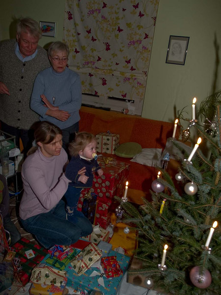 Sunday 24th Dec 06 - Cai gets to see his first christmas tree, note the real candles, nothing artificial here ;-)