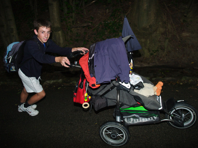 Tuesday 1st Aug 2006 - Michael gets to push Cai to the village August 1st party, its the day where the boys get to play with fireworks all day long, they got very upset that we made them go rollerblading in the afternoon, it really upset their arson activity plans for the day.