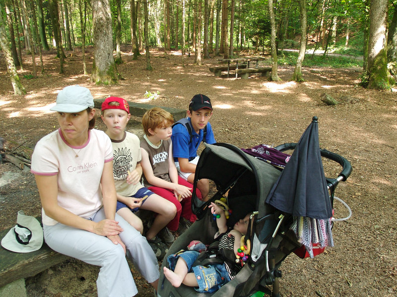 Friday 29th July 2006 - Everyone looks deep in thought as we have a quick snack stop in the woods.