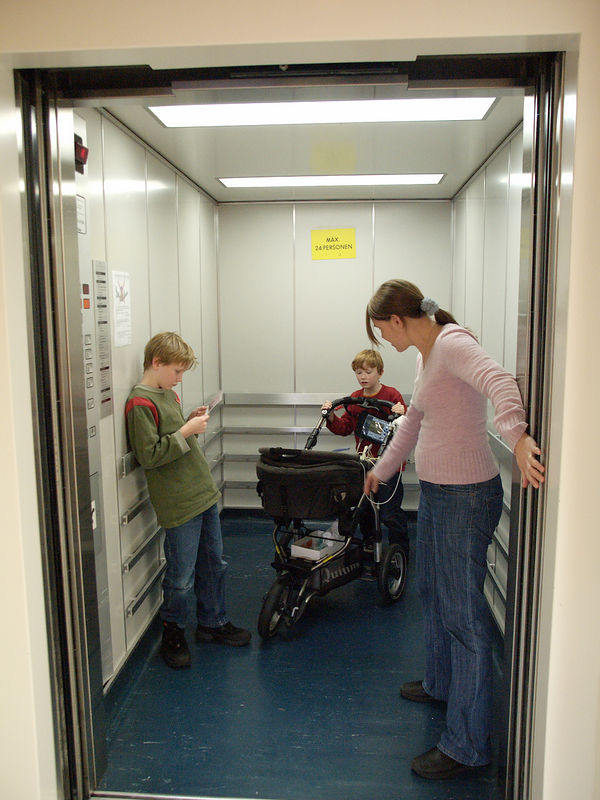 Saturday 17th Dec 05 - Cai's first lift journey - well at least in a pram but I guess it's nothing after the helicopter