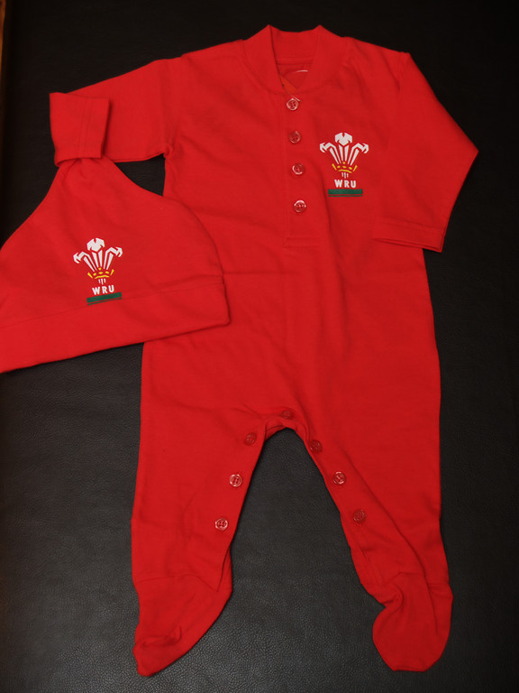 Saturday 5th Nov 05 - Cai gets his babygro ready for the game on saturday - for the non rugby people wales are playing new zealand on saturday - celebrating 100 years<br /> <br /> We would also like to thank everyone for their best wishes and cards - every gesture has been appreciated.