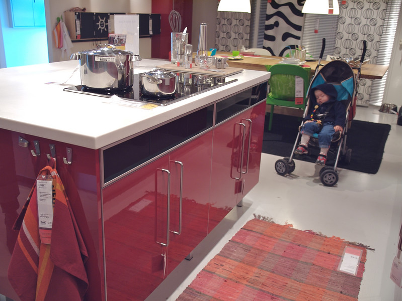 Sunday 30th Sep 2007 - Cai shows what he thinks of IKEA Kitchens.<br /> <br /> We are still waiting for news on Cai's hearing aids, but we are also busy with other things which are taking priority. Cai continues to do well and we are pleased that he now has some independance with his trolley, he is enjoying exploring the house, such a change for a boy who I once thought would never feel rain on his face is now happily getting about.<br /> <br /> We now as of this week finally have planning permission to extend the house and I have been busy restoring the beams and floor in the attic, while Kerstin has been busy clearing the cellar for the new heating system. The roof leaks and the heating is broken, both must be replaced before winter, we hope that they will start on them next month, now I just need to remember where we put that winning lottery ticket :-)<br /> <br /> Events to note - My brother and sisters (kim and Sandra) wedding anniversary was yesterday along with Auntie Beryl's, however a day which should have been happy was marred by Wales losing to Fiji in what was one of the most exciting games of Rugby I have seen in a long time, now I have no excuse to watch the game against South Africa in the pub next weekend - so its back to the attic I suppose.