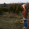 Baldwinsville, NY, 12-03-17: An elderly man searches for a Christmas tree to cut down.