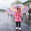Syracuse Ny, 5-14-17: A little girl with an umbrella tries to stay out of the rain.