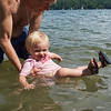 Ivy kicks her legs in the water with Grandpa on 08/13/2016. She is 1year and a half.