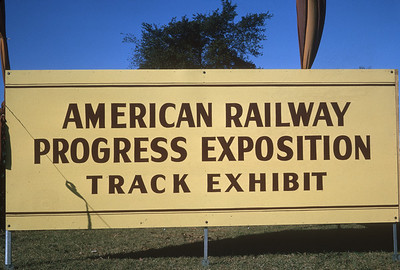 2021.004.9.ARPE-001--j david ingles 35mm kodachrome--none--American Railway Progress Exposition entrance sign at ICRR 31st St yard--Chicago IL--1963 1000
