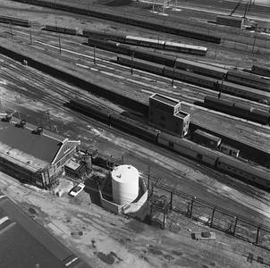 2021.004.3.013-01--j david ingles 120 neg--ICRR--view looking down at interlocking tower with northbound ICRR passenger train last day of Central Station--Chicago IL--1972 0305