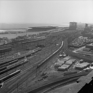 2021.004.3.012-01--j david ingles 120 neg--ICRR--view looking south at 18th St yard with northbound ICRR passenger train last day of Central Station--Chicago IL--1972 0305