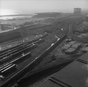 2021.004.3.013-08--j david ingles 120 neg--ICRR--view looking south at 18th St yard with southbound ICRR passenger train last day of Central Station--Chicago IL--1972 0305