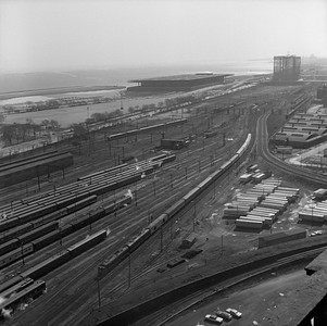 2021.004.3.012-02--j david ingles 120 neg--ICRR--view looking south at 18th St yard with northbound ICRR passenger train last day of Central Station--Chicago IL--1972 0305