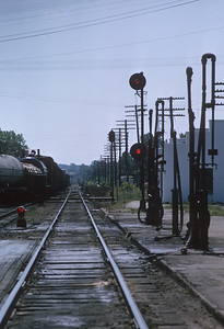 2021.004.9.INDY-027--j david ingles 35mm kodachrome--ERIE--view looking east down track with signals--Huntington IN--1963 0800