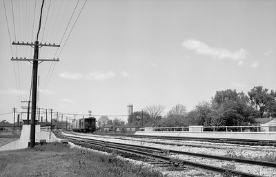 2021.004.3.001-03--j david ingles 6x9 neg--NYC--caboose on hind end of northbound freight train scene--Fostoria OH--c1961 0000