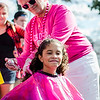 Gabby DaSilva, 10, gets her hair spray painted pink by Kathy DiRusso to raise money and awareness for breast cancer during the Johnny Appleseed Festival on Saturday afternoon in Leominster. SENTINEL & ENTERPRISE / Ashley Green
