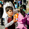 Abheek Khanal, 6, blows bubbles during the Johnny Appleseed Festival on Saturday afternoon in Leominster. SENTINEL & ENTERPRISE / Ashley Green
