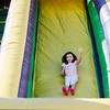 Megan Moriarty, 9, slides down the bouncy house during the Johnny Appleseed Festival on Saturday afternoon in Leominster. SENTINEL & ENTERPRISE / Ashley Green