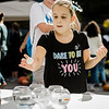 Grace Longtin, 8, plays a game to win a goldfish during the Johnny Appleseed Festival on Saturday afternoon in Leominster. SENTINEL & ENTERPRISE / Ashley Green