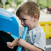 Dean DeMar, 2, enjoys ice cream from the Fidelity Bank truck during the Johnny Appleseed Festival on Saturday afternoon in Leominster. SENTINEL & ENTERPRISE / Ashley Green