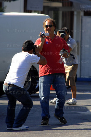 Actor James Belushi, took a camcorder from a Paparazzi and films them and stole the video.