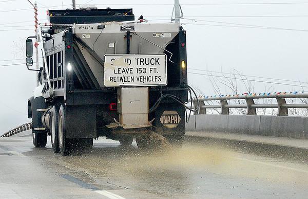 KEVIN HARVISON | Staff photo<br /> An Oklahoma Department of Transportation truck treats a bridge on East Carl Albert Parkway Wednesday evening.