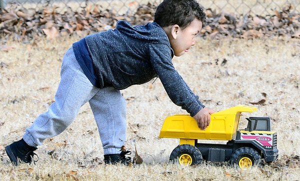 KEVIN HARVISON | Staff photo<br /> Tristen Walters keeps on trucking through his yard while enjoying some outside play time.