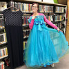 KEVIN HARVISON | Staff photo<br /> McAlester Public Teen Librarian Yuliya Zhugina shows off one of the prom dresses that has been collected by the Library for up coming Prom and stated every teen deserves a wonderful Prom experience and our goal is to help them look their best without breaking the bank. McAlester Public Library is now accepting donations for prom dresses, suits and tuxedos, shoes, accessories, jewelry in new or gently used conditoin for the Libraries spectacular event coming in March. Gift certificates for services such as hair styles and cuts, nails and make-up, drycleaning and more are also welcomed and appreciated. All items donated will be given free of charge to our deserving area teens and made available as a fun filled, stress free shopping experience. For more information call 918-426-0930.
