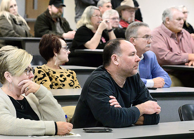KEVIN HARVISON | Staff photo Pictured from left, Cindy Basolo and her husband Pat Basolo, listen during the Town Hall Meeting at the Eastern Oklahoma State College McAlester Campus, about the intersection problems on U.S. 69.
