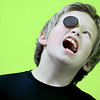 "Kevin Harvison | Staff photo<br /> Emerson Elementary student Legend Holmes attempts to move a cookie down his face into his mouth without using anything, during a ""face the cookie"" game at the school's carnival."