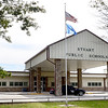 Kevin Harvison | Staff photo <br /> A tattored flag flies in front of Stuart Public School.