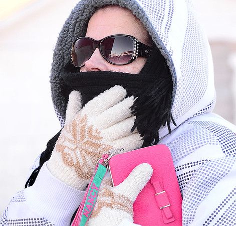 Kevin Harvison | Staff photo<br /> Nancy Crain of McAlester is bundles up as she battles the cold weather going from her vehicle to the store Tuesday morning.