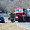 Kevin Harvison | Staff photo<br /> A warer tanker truck from the Haileyville Fire Department pulls onto a road leading to a gas well fire near Quinton early Monday as Oklahoma Highway Patrol troopers direct traffic. Personal from multiple agencies converged on the scene to help with the emergency opperations. More details will be posted as available.