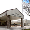 Kevin Harvison | Staff photo <br /> A flag flies in front of Stuart Public School.