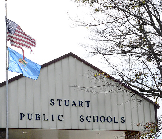 Kevin Harvison | Staff photo<br /> A tattord flag flies in front of  Stuart Public School.