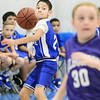 Kevin Harvison | Staff photo<br /> A Hartshorne Miner fourth grade basketball player passes the ball down court during the annual Big Mick Tournment honoring long time Hartshorne coach Mickey Beare.