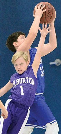 Kevin Harvison | Staff photo<br /> A pass gets completed to a Hartshorne Miner over the top of a Wilburton Digger fourth grade player  during the annual Big Mick Tournment honoring long time Hartshorne coach Mickey Beare.