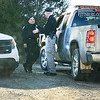 Kevin Harvison | Staff photo<br /> Pittsburg County Deputies talk outside the well site of the Patterson 219 rig explosion that killed five men and injured one Monday. Oklahoma Highway Patrol Troopers along with Sheriff Deputies guard the entrance to the site.