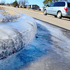 Kevin Harvison | Staff photo<br /> Layers of ice are still frozen on a curb on Fillmore Avenue.