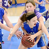 Kevin Harvison | Staff photo<br /> A Hartshorne Lady Miner fourth grade basketball player yells for help as she is covered up during the annual Big Mick Tournment honoring long time Hartshorne coach Mickey Beare.