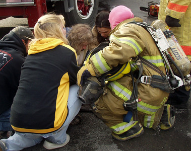 "Mahanoy City firefighters and EMS work to revive a pit bull named ""Bronx"" after he was overcome by smoke during a Wednesday afternoon fire. The dog survived, officials said."