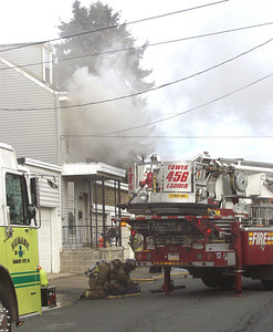 Smoke pours from a home on East Market Street in Mahanoy City Wednesday afternoon.