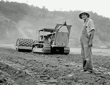 CANVAS-man_in_field_in_front_of_tractor