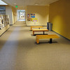 Extra wide corridor and common space.  Benches are made from lumber reclaimed from a tree on the site.   During construction, the trees were evaluated for re-use.    Unusable trees were let in the wooded 5 acres adjoining the school