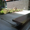 Sit spot near the rain garden bio-swale.  Used bu the students for observing the rain garden.