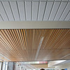 Wood slat ceiling treatment installed in several places in the building