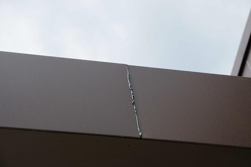 Bit of caulk between siding panels.