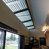 Skylights along outside edge of classroom.  This allows light in to balance the naturla light entering from the other side.