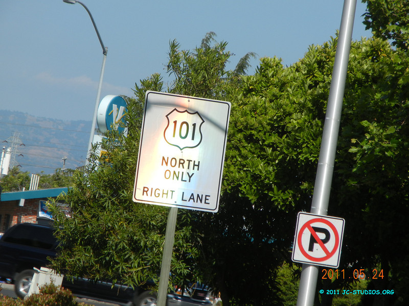 05/24/11 - Santa Clara, CA. Saw a rainbow on the road sign. This is the best one I got, some blue, green and red..