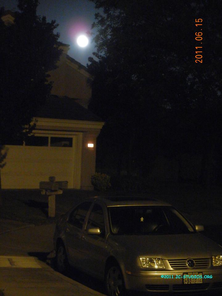 06/15/11 - Full Moon above my neighbor's house. I like bluish sky.